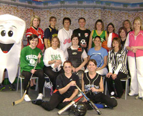 team dressed in sports costumes