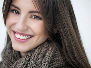 woman with scarf on smiling